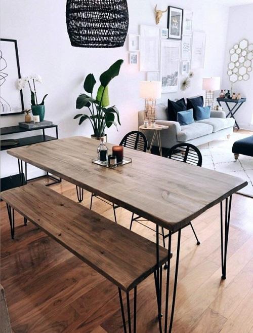 Mesa com banco de madeira em estilo rústico.