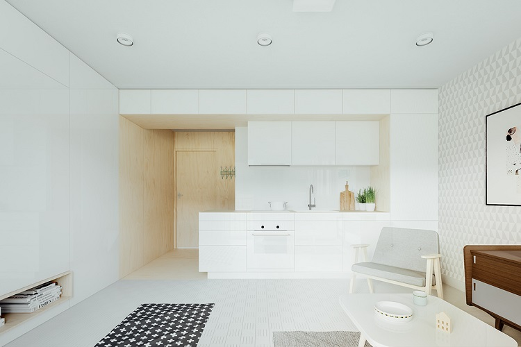 Cozinha em espaço aberto decorada no estilo minimalista.
