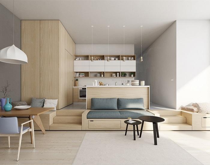 Cozinha minimalista integrada com área de estar elevada por degraus.